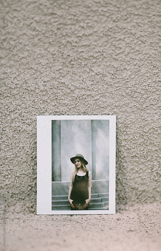 instant photo of the young woman with hat by Alexey Kuzma for Stocksy United