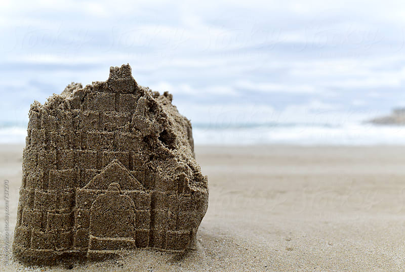 ruined sandcastle on the beach by juan moyano for Stocksy United