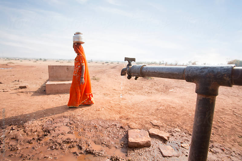 Indian woman collecting water. Rajasthan. India by Hugh Sitton for Stocksy United