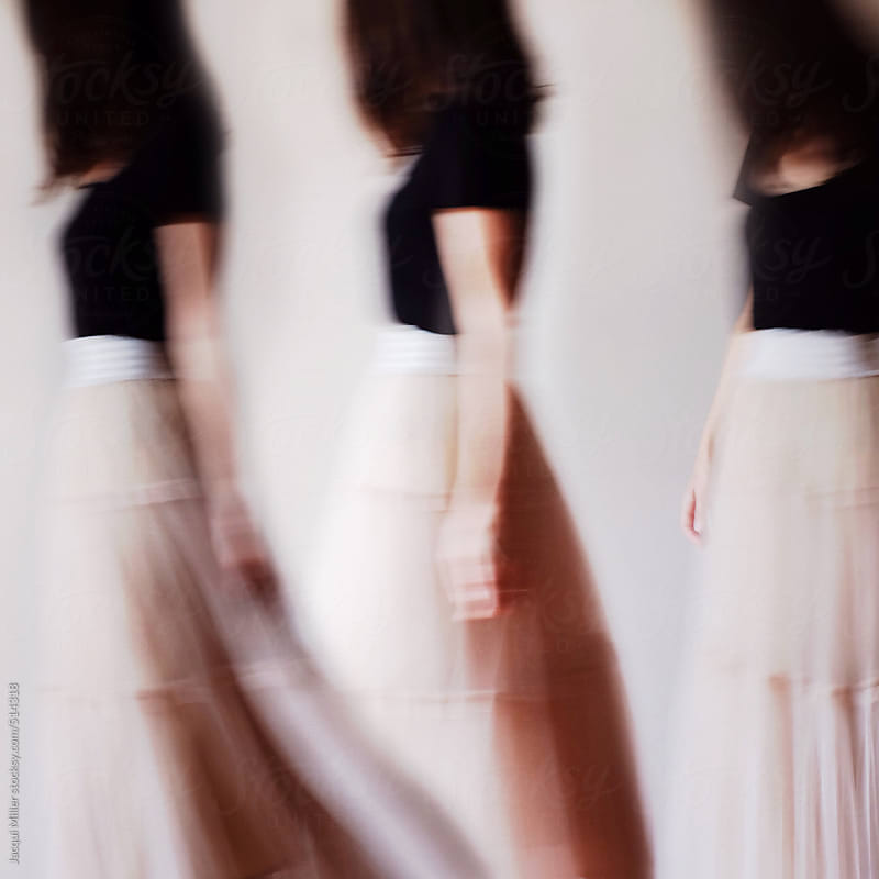 Composite of three images, of the same women, wearing a long tulle evening skirt by Jacqui Miller for Stocksy United