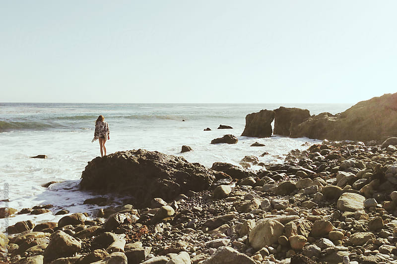 Woman On Coastal Rock by Kevin Russ for Stocksy United