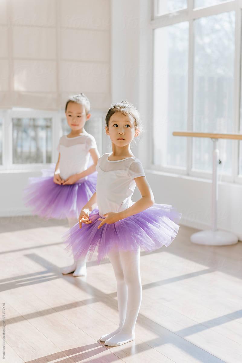 Children Practicing Ballet Poses In Ballet Studio By Maahoo Studio Stocksy United
