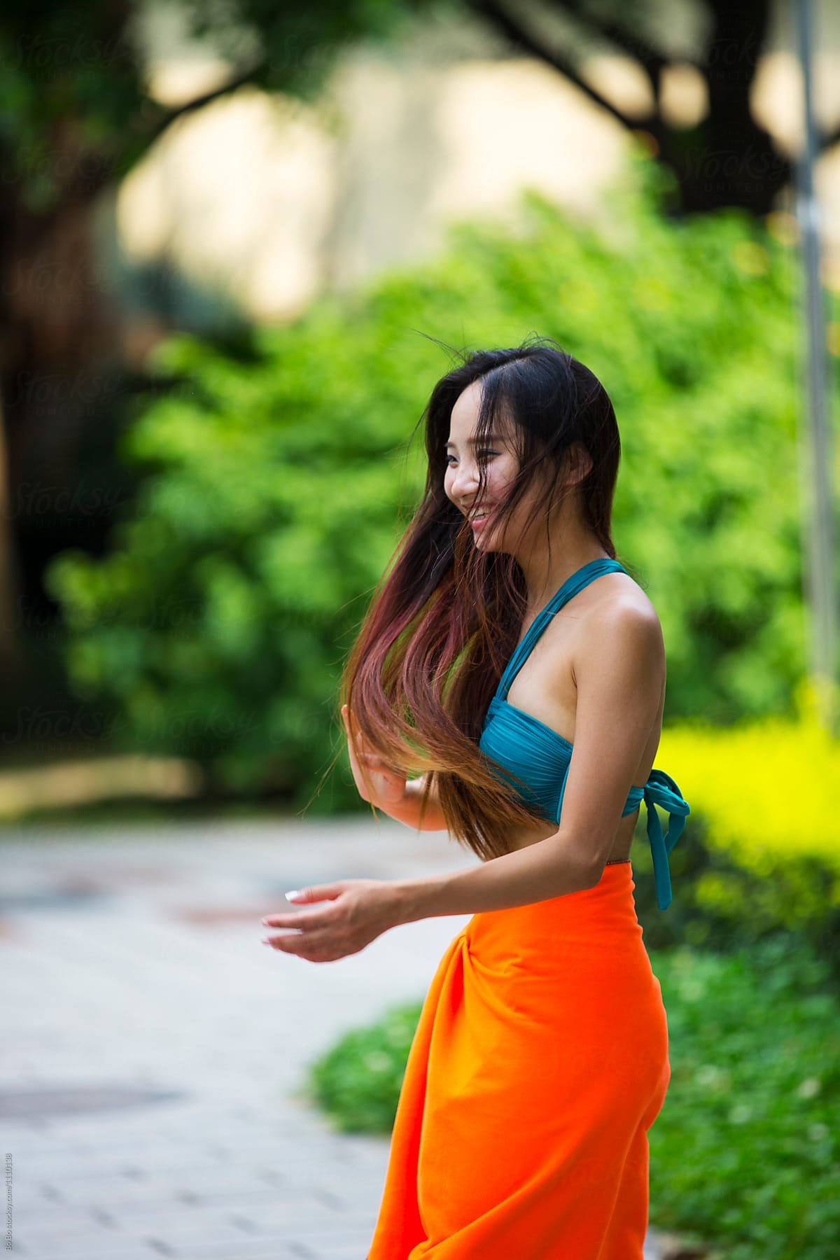 Pretty Young Asian Woman Wearing Bikini In The Garden