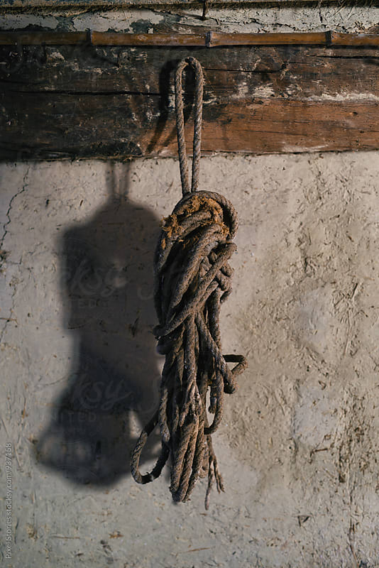 Old rope hanging on a wall by Pixel Stories for Stocksy United
