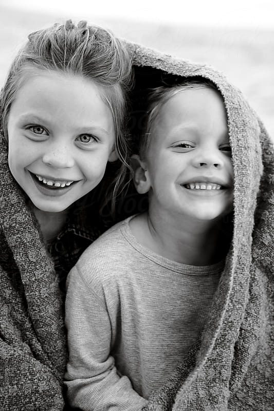 Brother And Sister Sharing Blanket Outdoors by Dina Giangregorio for Stocksy United