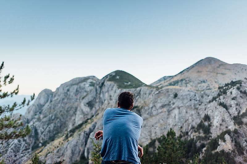 Man having a rest and watching the mountains by Boris Jovanovic for Stocksy United