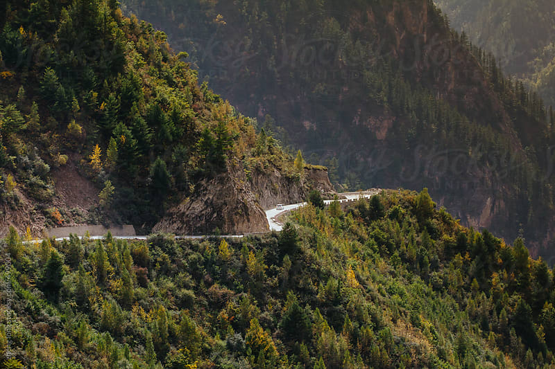 car running on the mountain road in Tibet by zheng long for Stocksy United
