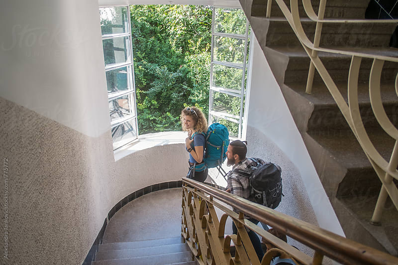 Young People with Backpacks Going Upstairs in the Old Building by Aleksandra Jankovic for Stocksy United