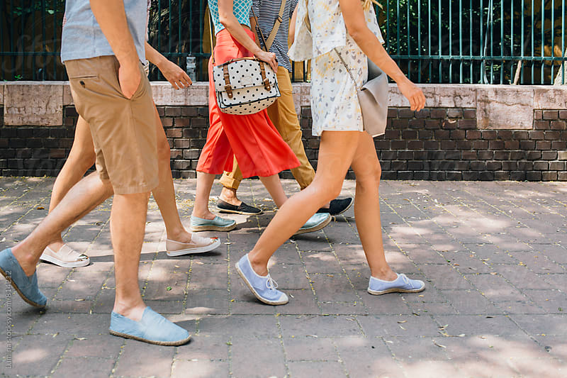 Friends Walking on the Street by Lumina for Stocksy United