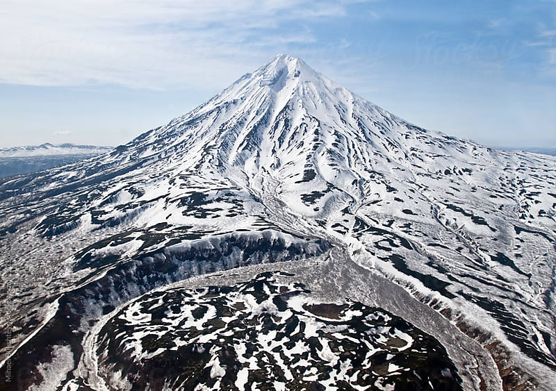 Aerial view of a snow-covered extinct volcano by Mihael Blikshteyn for Stocksy United