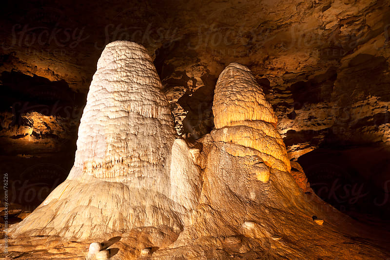 Giant Twin Stalagmites Inside a Missouri Cave by Brandon Alms for Stocksy United