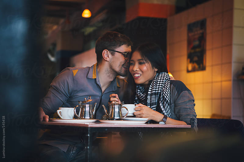 Multiethnic Couple at a Cafe by Lumina for Stocksy United