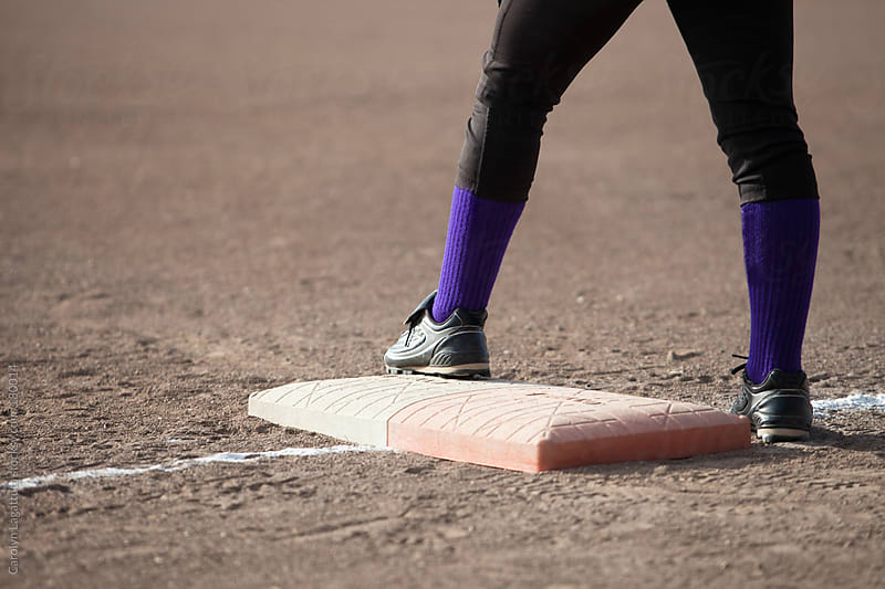 Standing on first base - ready to run by Carolyn Lagattuta for Stocksy United