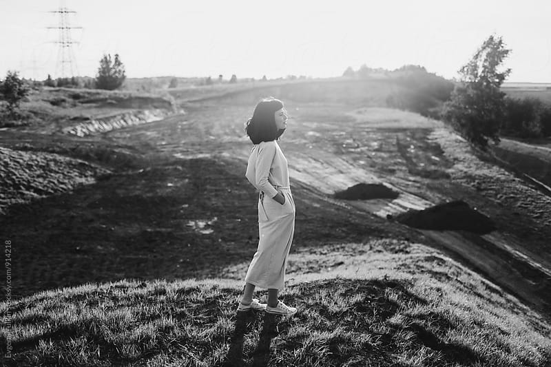 Young girl standing on wasteland by Evgenij Yulkin for Stocksy United