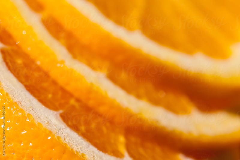Macro of orange citrus fruit slices by Kerry Murphy for Stocksy United
