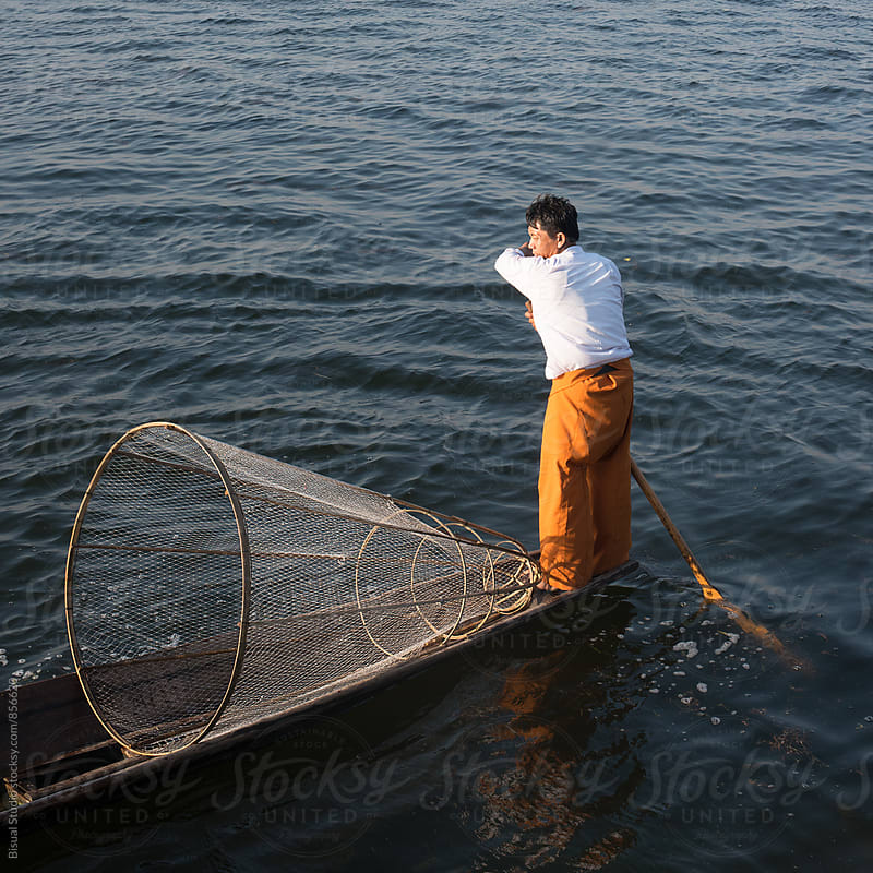 Traditional fisherman on Inle lake by Bisual Studio for Stocksy United