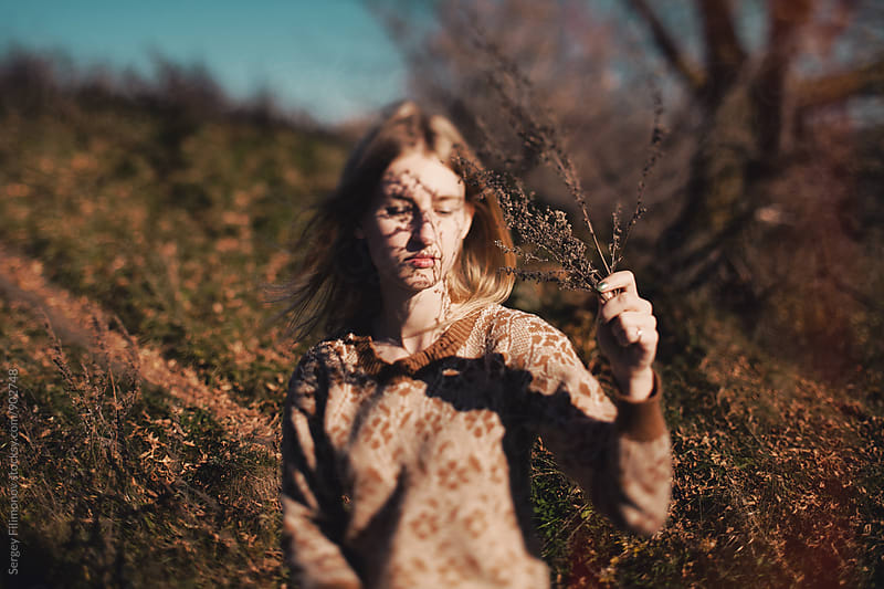 Beautiful young girl with shadows from a grass on a face by Sergey Filimonov for Stocksy United