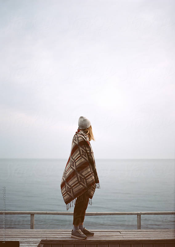 Woman at the cold sea by Lyuba Burakova for Stocksy United