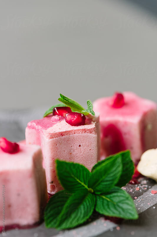grapefruit and pomegranate frozen parfait dessert by Gillian Vann for Stocksy United