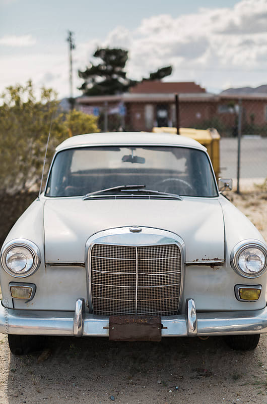 Old automobile in car parking lot by Matthew Spaulding for Stocksy United