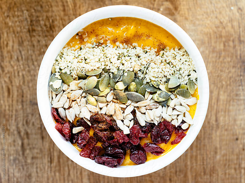 Pumpkin Smoothie Bowl by Harald Walker for Stocksy United