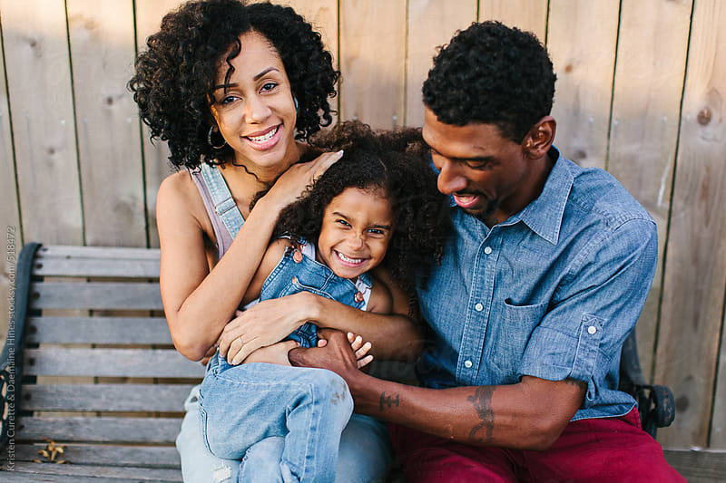 Horizontal portrait of a beautiful African American family of three by Kristen Curette Hines for Stocksy United