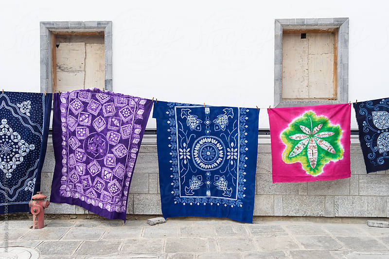 Colorful batik hanging outdoors by MaaHoo Studio for Stocksy United