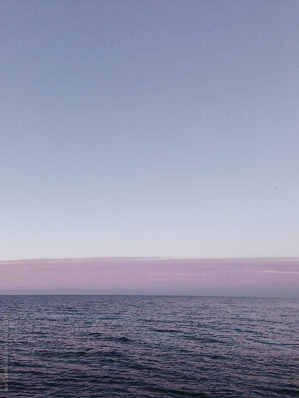Calm sea before sunrise by Bor Cvetko for Stocksy United