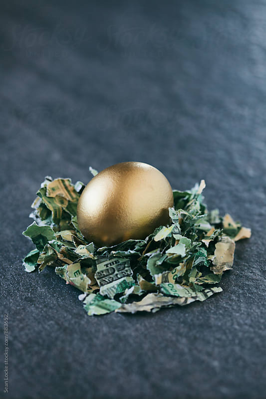 Easter: Golden Egg Sits In Nest Of Shredded Money by Sean Locke for Stocksy United