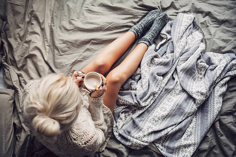 Woman Drinking Hot Coffee in Bed in the Morning by Lumina for Stocksy United