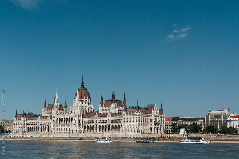 Hungarian parliament in Budapest over the Danube river by Gabriel (Gabi) Bucataru for Stocksy United