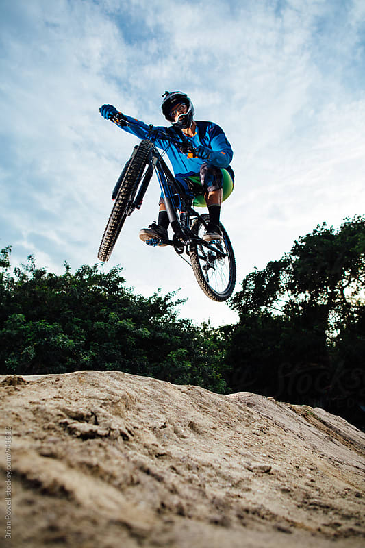 mountain bike pro jump by Brian Powell for Stocksy United