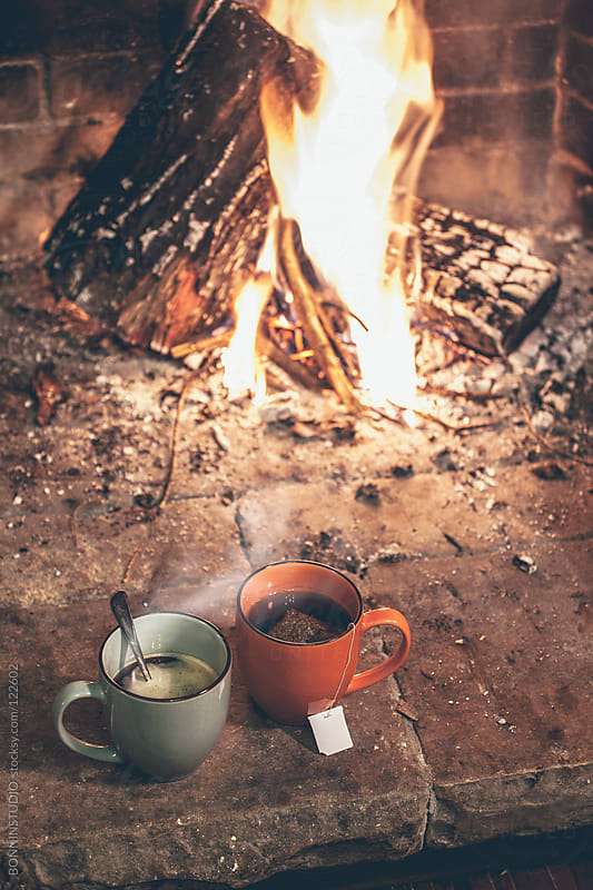 Hot cups of coffee and tea in a fireplace. by BONNINSTUDIO for Stocksy United
