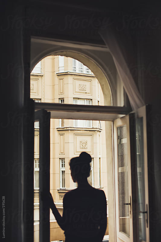 Woman Standing by the Window by Lumina for Stocksy United