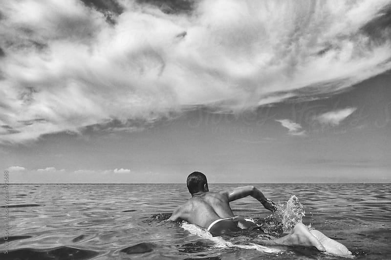 Young man surfing by Silvia Cipriani for Stocksy United