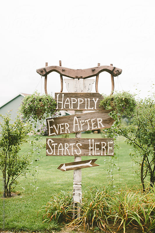happily ever after wooden sign at wedding by Nicole Mason for Stocksy United