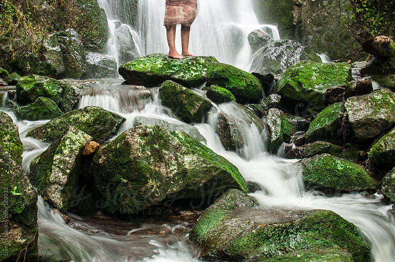 Woman Standing by a Waterfall by Lumina for Stocksy United