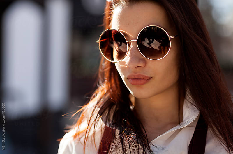 Beautiful young woman with vintage sunglasses by MEM Studio for Stocksy United