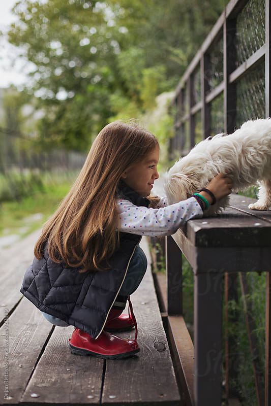 Girl's friendship with dog. by Dejan Ristovski for Stocksy United