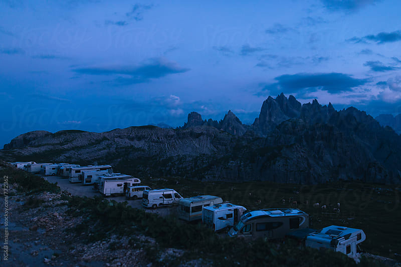 Caravan parking in the mountains at dusk by RG&B Images for Stocksy United