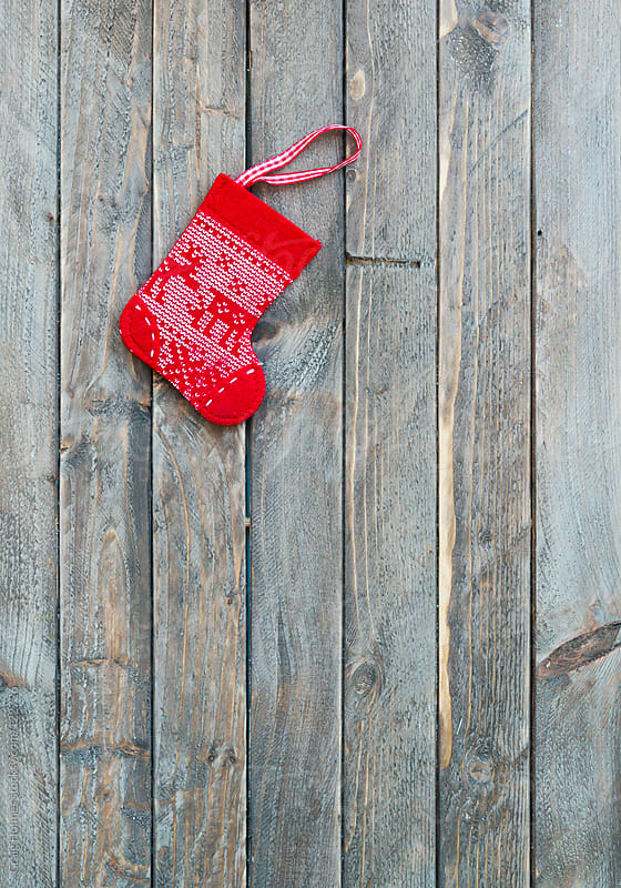 Christmas stocking decoration by Craig Holmes for Stocksy United
