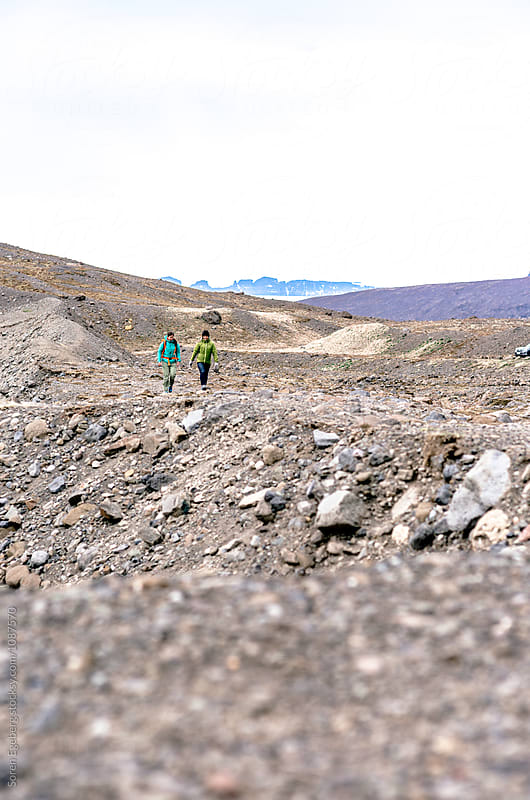 Female couple hiking in Iceland by Søren Egeberg Photography for Stocksy United