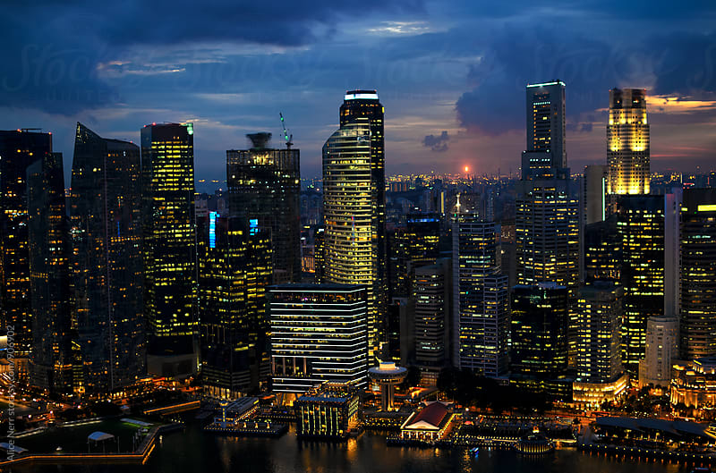 Singapore cityline at night by Alice Nerr for Stocksy United
