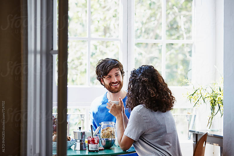 Happy Couple Having Breakfast At Home by ALTO IMAGES for Stocksy United