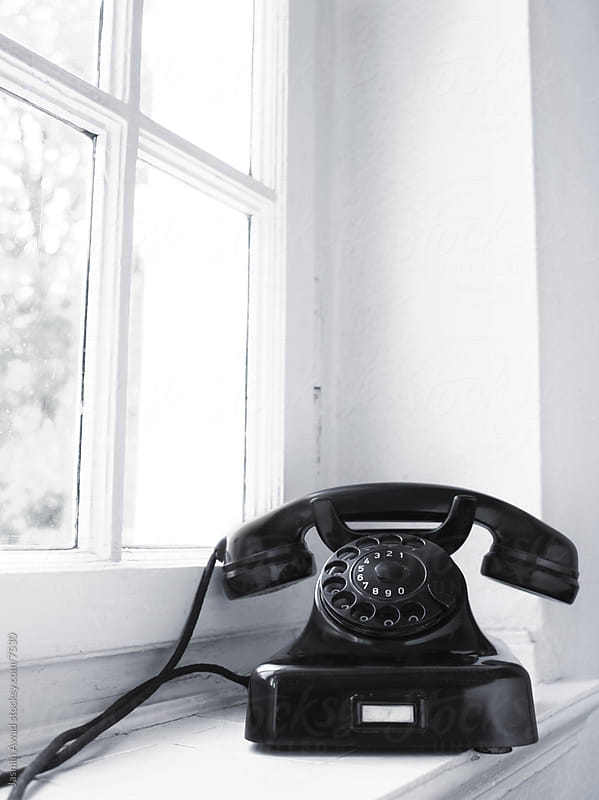 Old Vintage Black Telephone Sitting on Window Sill by Jasmin Awad for Stocksy United