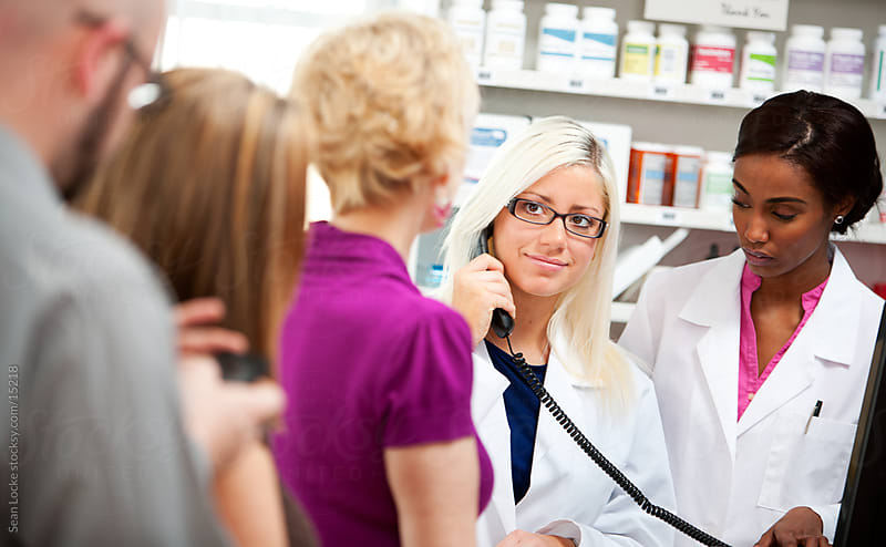 Pharmacy: Pharmacist Calls in Question to Doctor by Sean Locke for Stocksy United