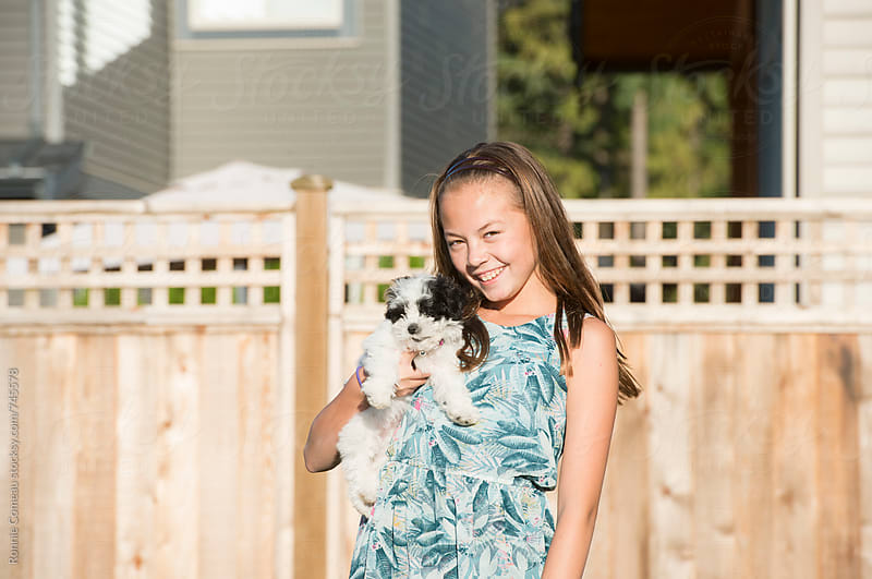 A Girl And Her Dog by Ronnie Comeau for Stocksy United