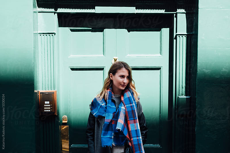 Portrait of a Woman in Front of the Green Door by Katarina Radovic for Stocksy United