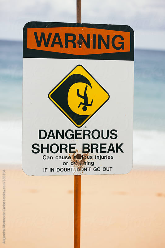 Warning beach sign with words Dangerous shore break by Alejandro Moreno de Carlos for Stocksy United