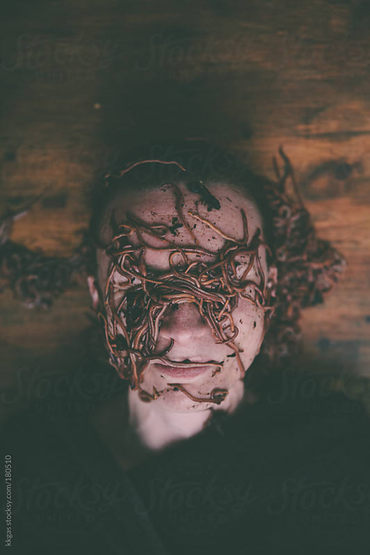 Woman with face covered by worms by kkgas for Stocksy United